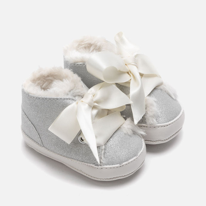 Treat little ones to their first pair of booties with these sweet silver shoes Spanish fashion brand, Mayoral. Crafted from a soft fabric, they're finished with a satin bow and would look adorable paired with any outfit.