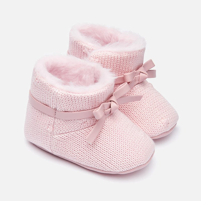 Mayoral Singapore Baby Girl Pink Booties. Treat little ones to their first pair of booties with these sweet pink shoes Spanish fashion brand, Mayoral. Crafted from a soft fabric, they're finished with a bow and would look adorable paired with any outfit.