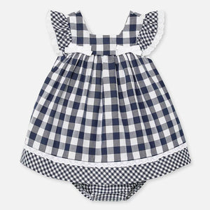 Mayoral Singapore Plaid Dress. This pretty black and white gingham print dress is perfect for sun-soaked days. Crafted in soft cotton, it is fully lined in lightweight cotton, with bows and ruffles on the bodice. There is an invisible zip on the back to fasten. Add a hair clip and a pair of sandals for an effortless yet chic look.