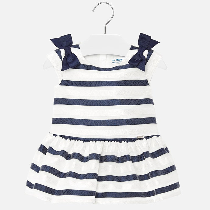 Mayoral Singapore Striped Dress. White and blue striped dress from Mayoral, made in soft organza. It has navy blue and white glittery stripes, with an under-layer and a lightweight cotton lining. There are pretty blue bows on the shoulders.