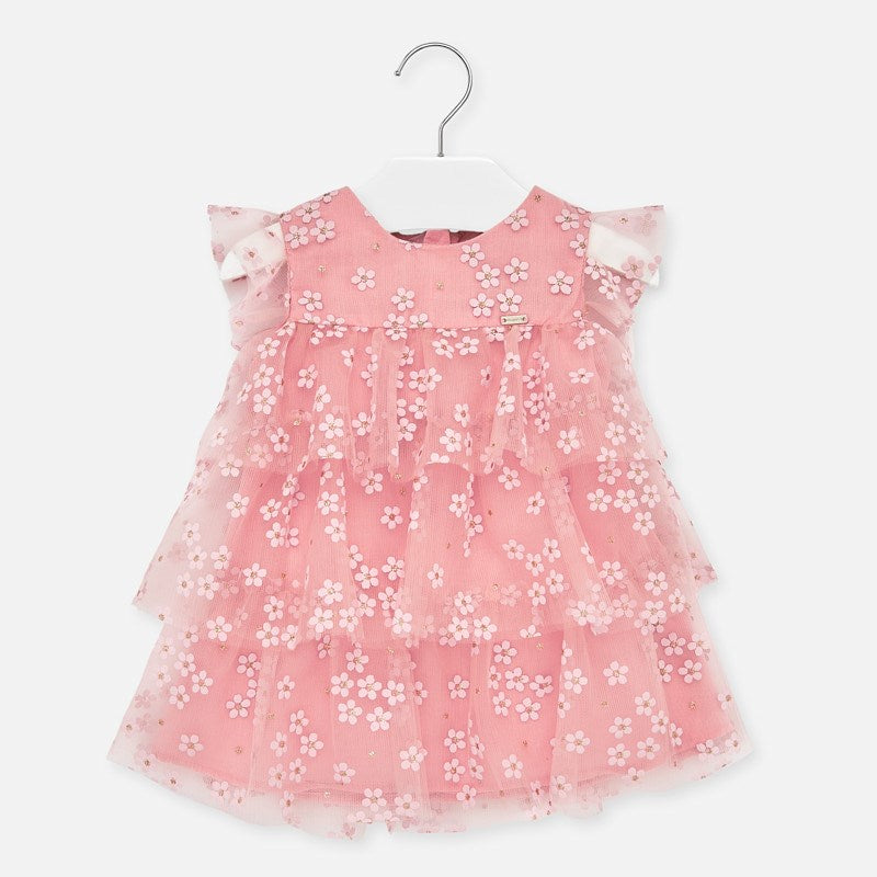 Mayoral Singapore Tulle Floral Dress. Pink dress for baby girls from Mayoral, with a printed white floral pattern. It is made in soft layers of tulle, with ruffle sleeves and a lightweight cotton lining.