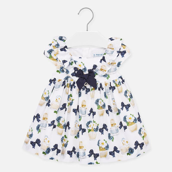 Mayoral Singapore Perfume Dress for Baby Girls. Give their wardrobe a sweet new addition with this delicate white and navy dress from Mayoral. With an all-over print, a beautiful navy bow and a zip closure on the back, it would look perfect paired with navy Mary Janes.