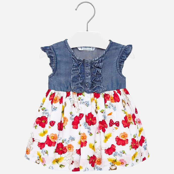 Mayoral Singapore Denim Floral Dress. Girls blue and white dress from Mayoral, with a red floral print on the skirt. The top is made in lightweight fabric, with ruffles and front button fastening. The soft cotton skirt is lined in lightweight polycotton.