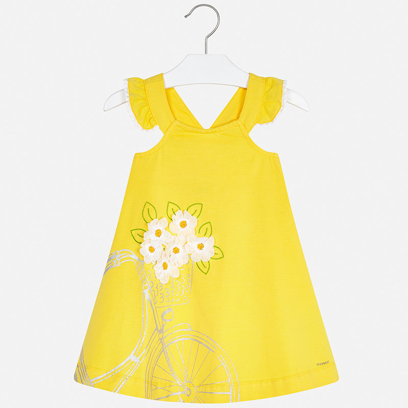 Mayoral Singapore Yellow Dress. Girls yellow dress from Mayoral, made in soft and stretchy cotton jersey. It has a silver bike print with white floral appliqués on the front. The back has fixed cross-over straps, with ruffle trims on the shoulders.