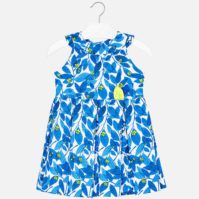 Mayoral Singapore Blue Cotton Dress. This amazing colorful dress by Mayoral will brighten up all sorts of occasions and seasons. It has a sleeveless design and a leafy print all over. Style with a pair of sandals from the brand for a completed look.