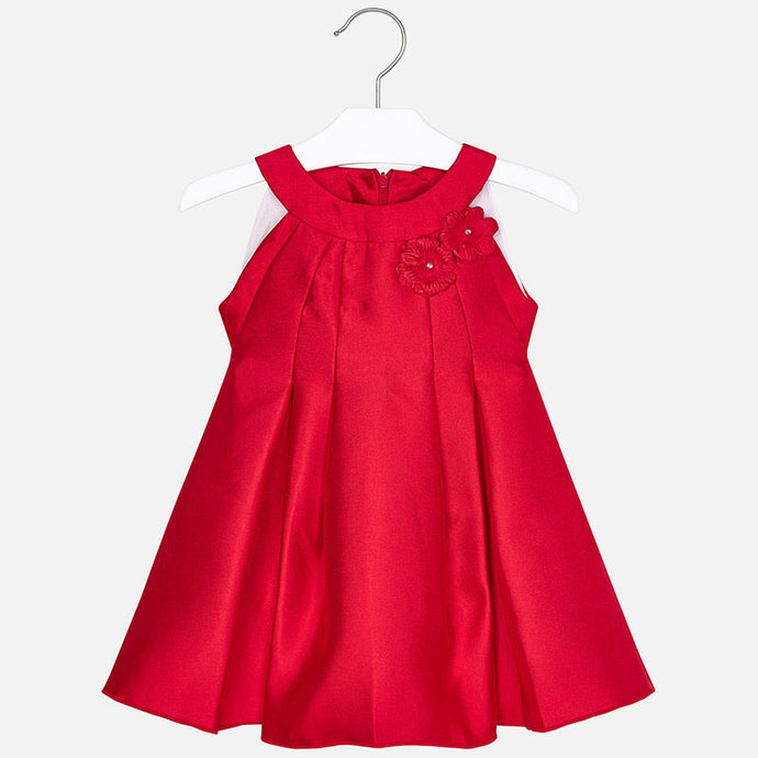 Mayoral Singapore Red Dress. Girls smart red dress by Mayoral, made in soft polyester taffeta with sparkly diamanté and pearl beads detail. The design features a round neckline and a gathered skirt with pleats.