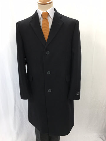 Black overcoat with white shirt and orange tie