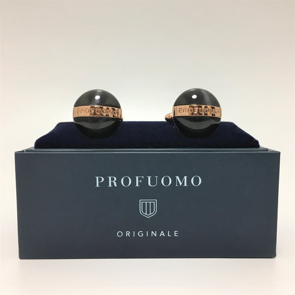 Profuomo named cufflinks sat on the cufflink box
