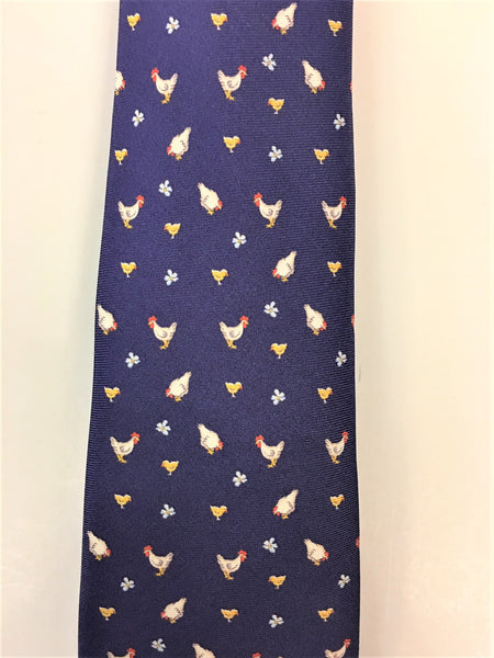 Air force blue silk tie with chicken and flower print close up