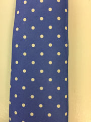 Blue silk tie with white dotted pattern close up