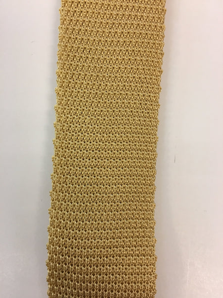 Close up of plain yellow knitted silk tie