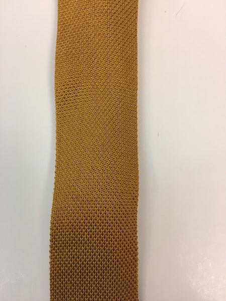 Close up of mustard knitted silk tie