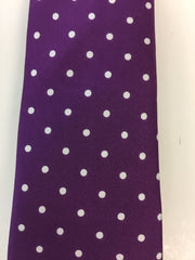 Purple silk tie with white dotted pattern close up
