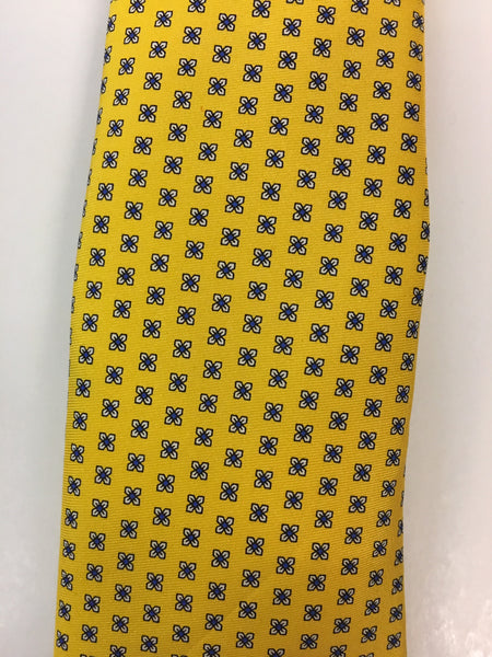 Yellow silk tie with flower print close up