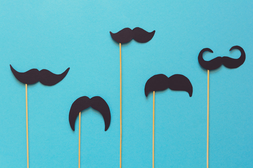 fakes mustaches on blue background