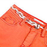 Orange stretch satin shorts with belt