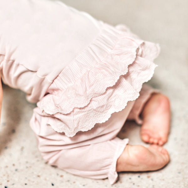 Pink popeline pants with ruffles