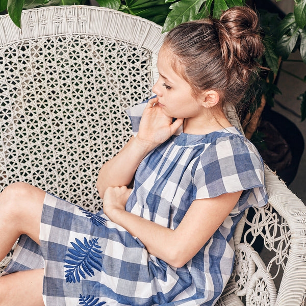 Dress with large navy gingham print and embroidery