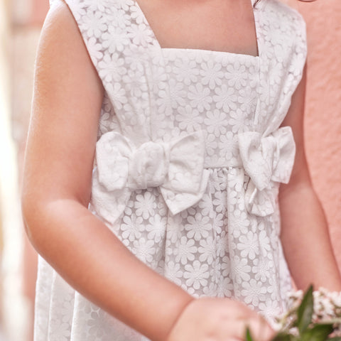 White pinafore dress with bows
