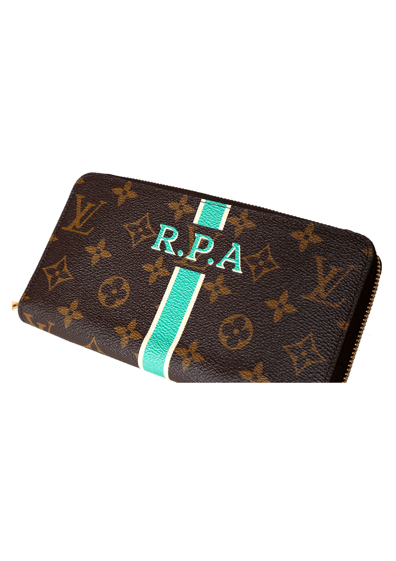 MONOGRAM ZIPPY WALLET