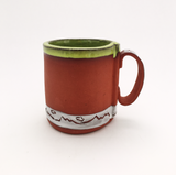 Red clay mug with kiwi glaze
