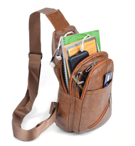 example of brown faux leather sling bag in use
