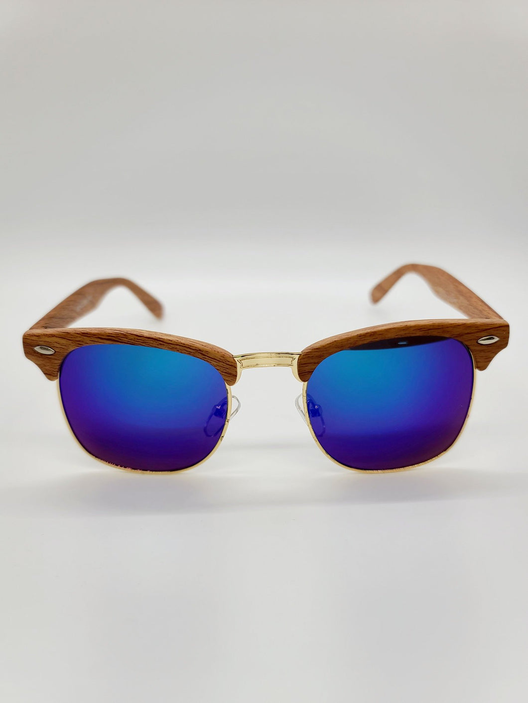 Aviator style sunglasses with wood pattern frames and blue/purple lenses