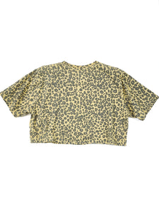 back of faded yellow cheetah print flower graphic short sleeve crop tee