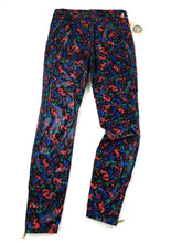 Load image into Gallery viewer, back of black with multi color spots faux leather zip bottom skinny pants