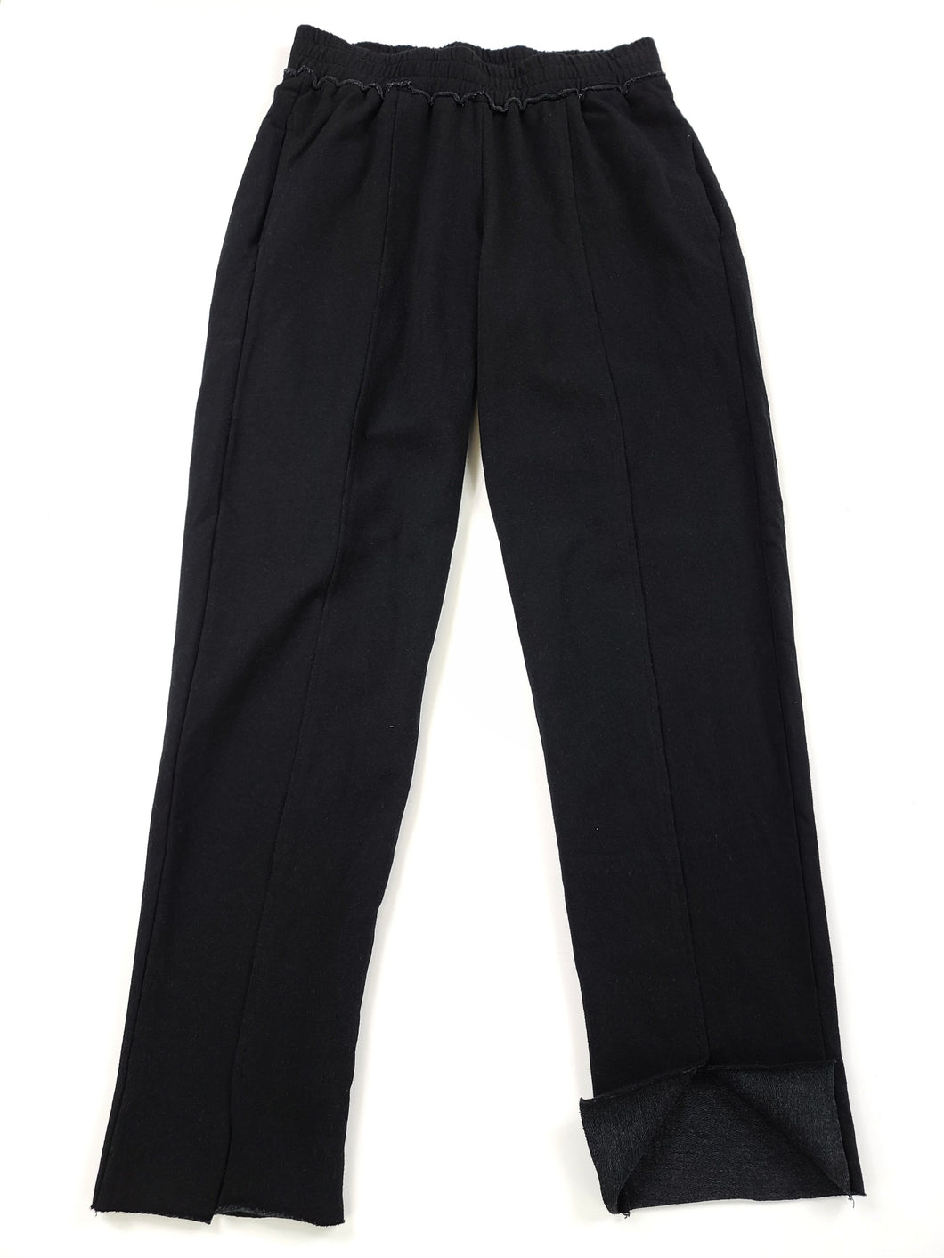 black elastic waist sweatpants with front seam and split bottom leg