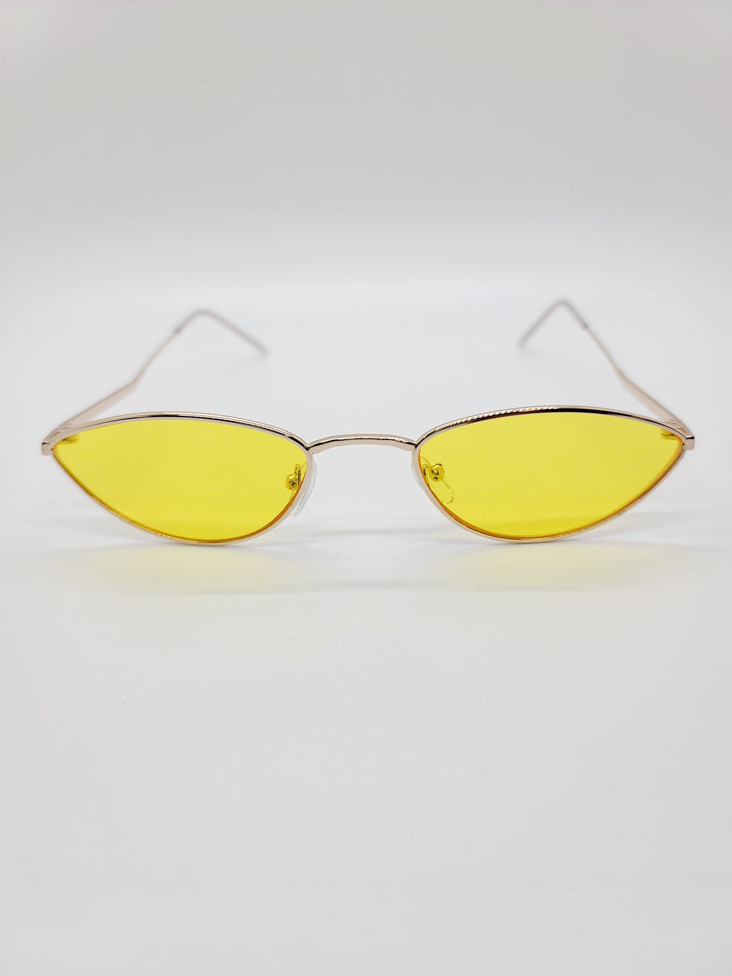 yellow clear lens angled arm cat eye sunglasses