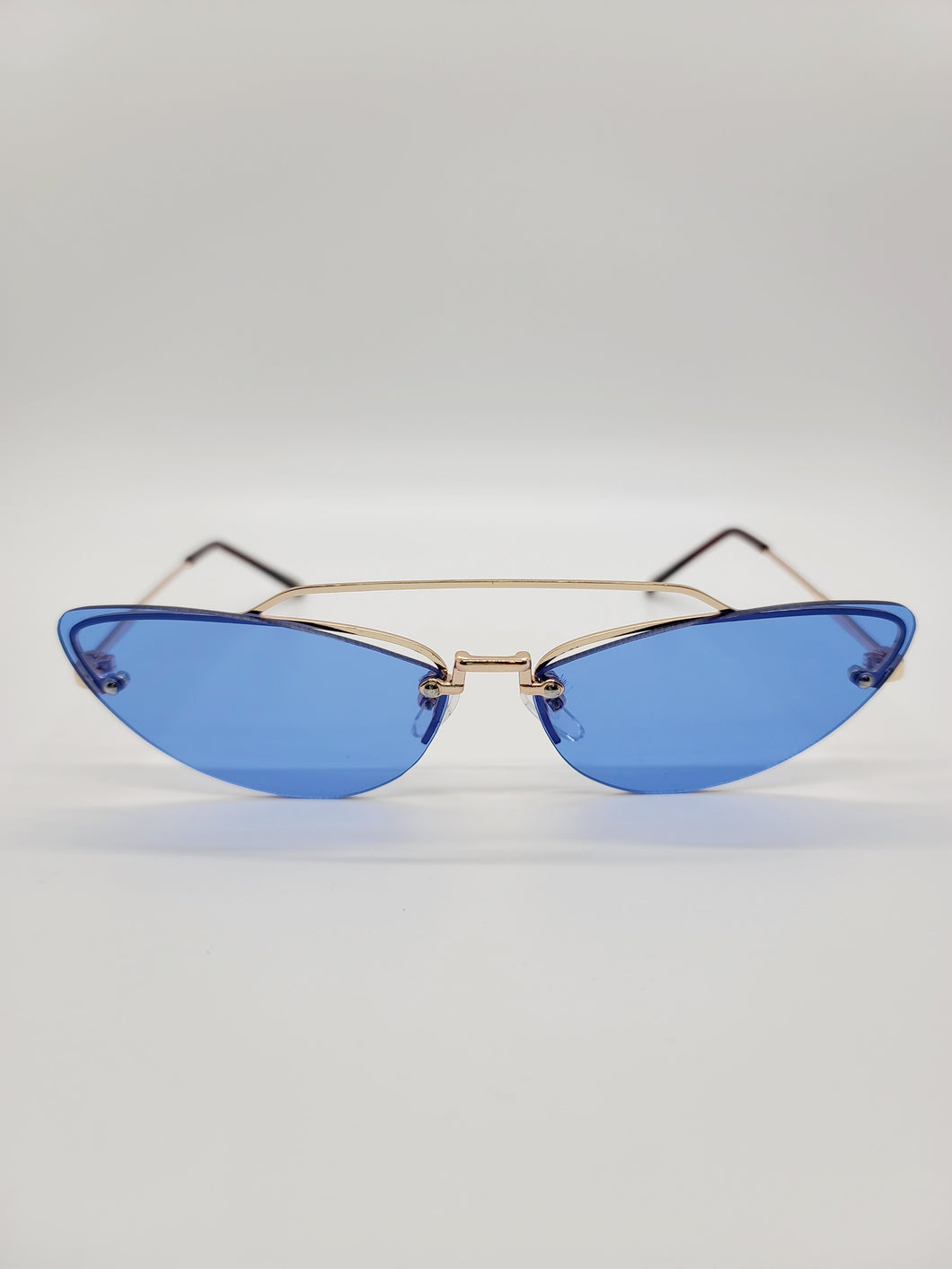 blue frameless wire arm cat eye sunglasses