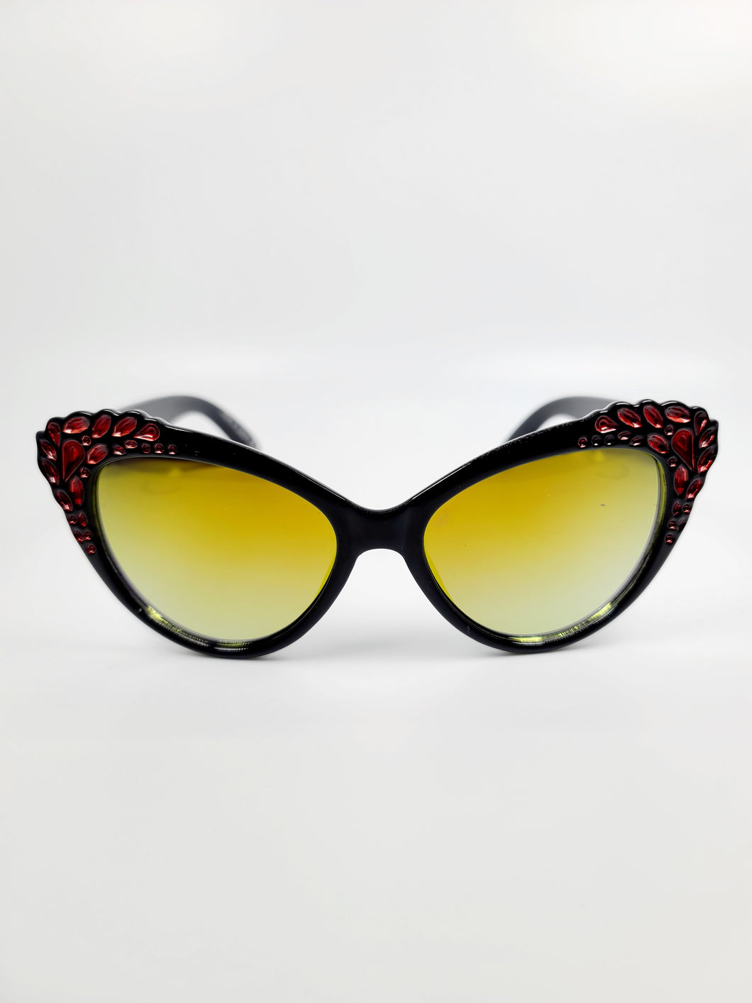 black cat eye frame yellow lens sunglasses with red gem detail