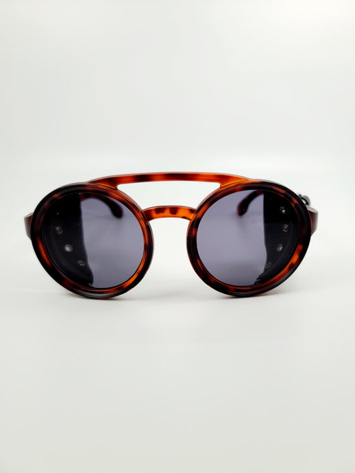 brown tortoise plastic with faux leather edge detail sunglasses