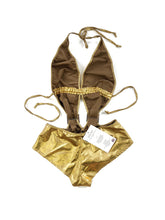 Load image into Gallery viewer, back of gold metallic monokini bodysuit with rhinestone buckles