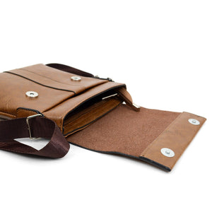 open flap of brown synthetic leather small crossbody messenger bag