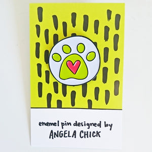 Angela Chick yellow and pink heart paw print enamel pin badge from Beezes