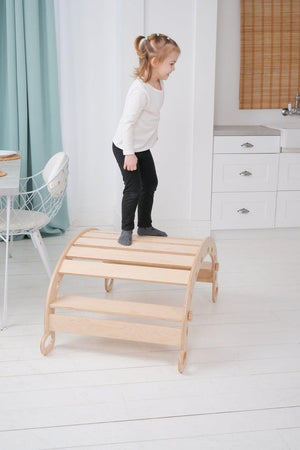 A child is playing in  Balance Board