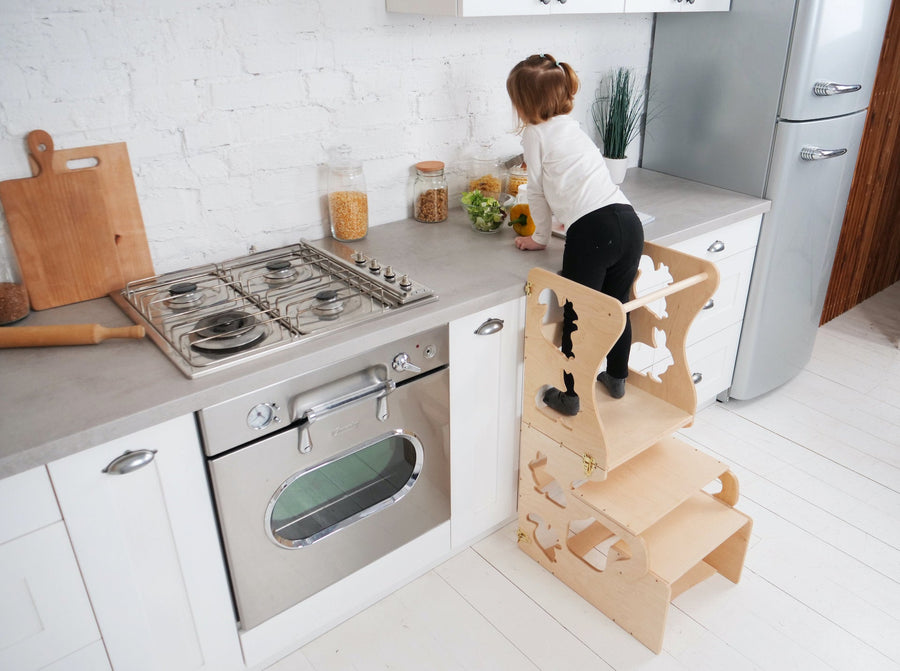 The child stands on a high chair and reaches the countertop. Kitchen step stool chair with animals.  DIMENSIONS of  Transformer  Kitchen tower   Height: 90 cm/35 inch Width: 50 cm/19.68 inch Length: 38 cm/14,96 inch