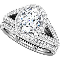 Style 102256: Split Shank Oval Halo Engagement Ring With Round Diamonds