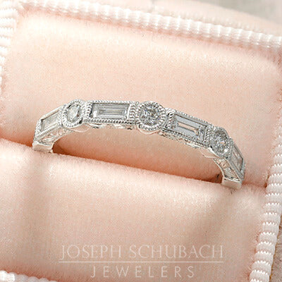Style 103373: The Kate bezel set baguette and round diamond wedding band with hand engraving.
