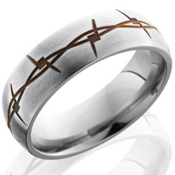 Style 103525: Titanium 7mm Domed Band with Anodized Barbed Wire Pattern
