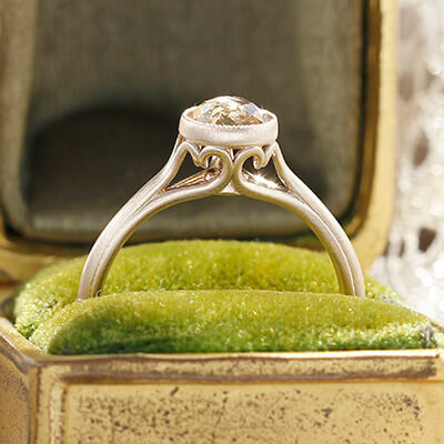 Style 103365: Bezel Set Scroll Solitaire Engagement Ring with Champagne Rose Cut Diamond