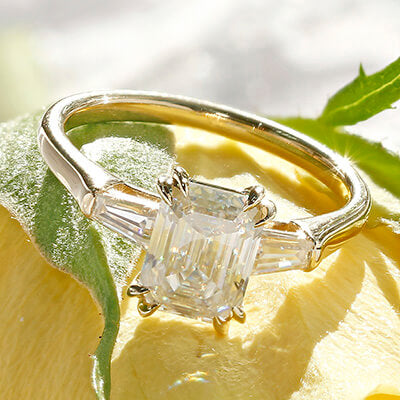 Style 103364: Manhattan Three Stone Emerald Cut Engagement Ring with Baguette Side Stones