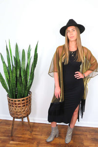 gold kimono with black fringe trim