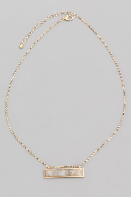 gold bar necklace with gray gemstone