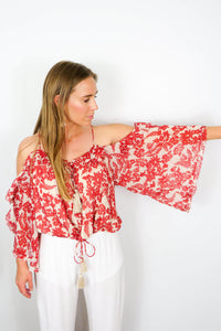 red floral off the shoulder shirt