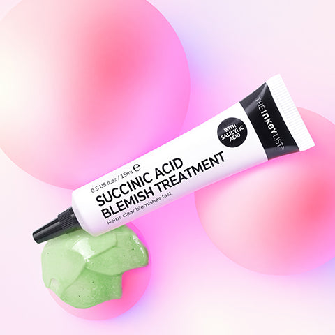 Succinic Acid Blemish Treatment product shot on a pink background