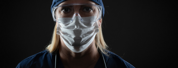 Female NHS worker wearing PPE
