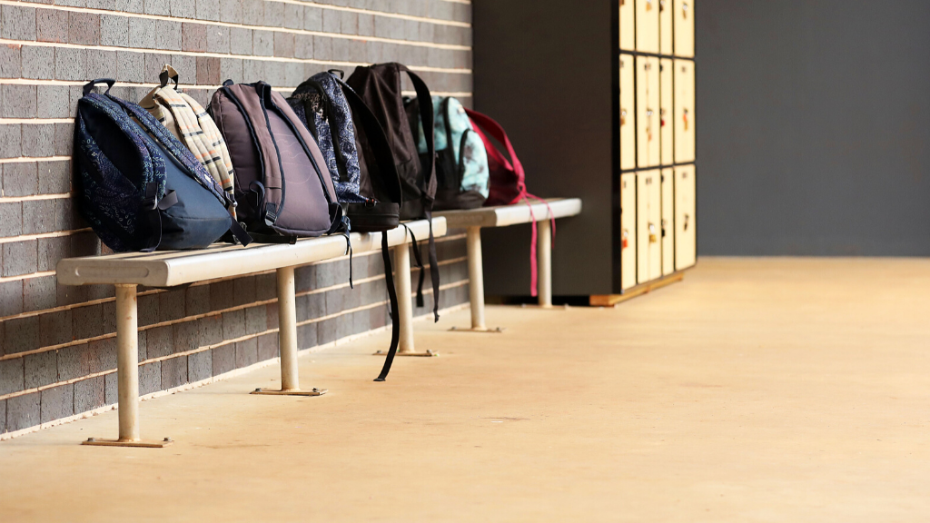 High School student school bags outside the classroom at an educational facility